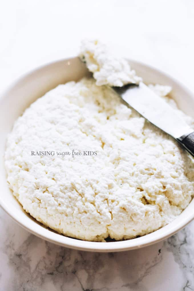 Homemade Ricotta | Raising Sugar Free Kids - homemade ricotta in 20 mins while you watch TV and wait for it to make itself? YES PLEASE! This recipe is 2 ingredients and incredibly easy, it tastes way better than the supermarket stuff and will save you money to boot!