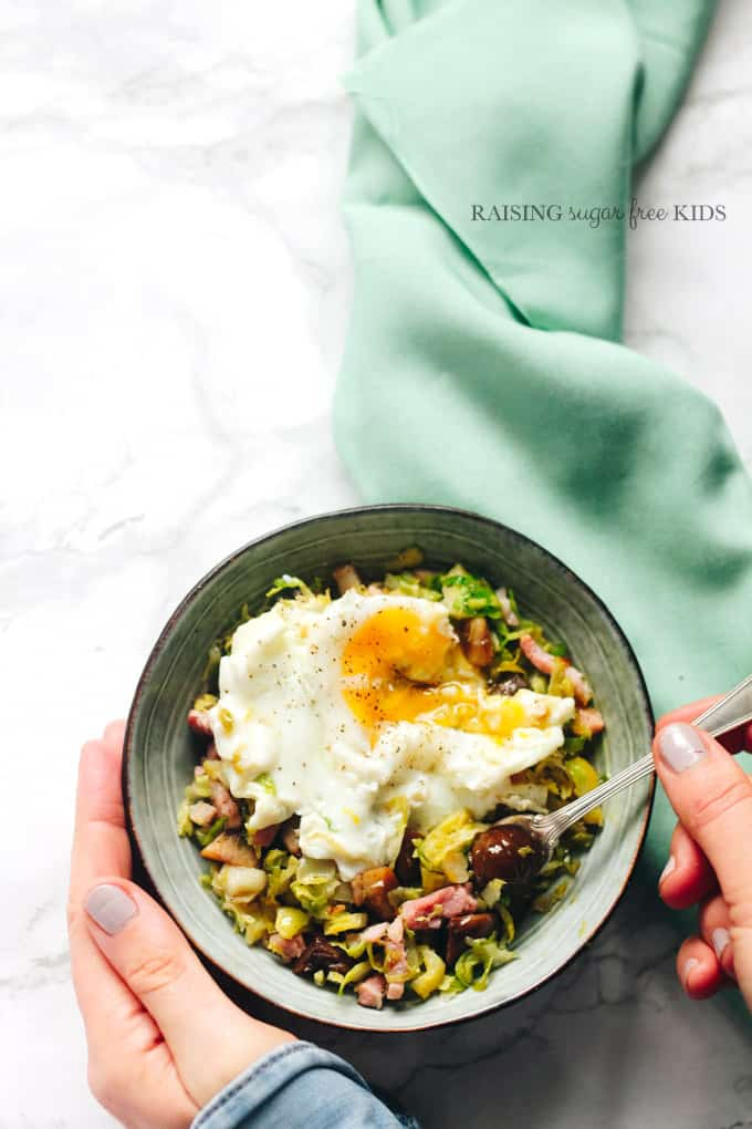Buttered Sprouts, Chestnuts & Bacon | Raising Sugar Free Kids - a classic side dish of sprouts cooked in lashings of butter with bacon and cooked chestnuts. My twist includes browned butter, shredding the sprouts to maximise sweetness and topping with Parmesan for extra decadence!