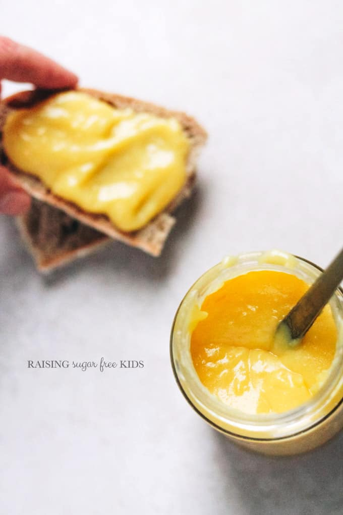 Sugar Free Lemon Curd | Raising Sugar Free Kids - a sugar free, gluten free, low carb version of lemon curd. Creamy, tart, sweet, filling, this curd can be made with 4 ingredients in 10 mins and can be used as shop-bought curd in layer cakes, poured over pancakes or sugar free ice cream, in pastry cases, spread on toast or however you like to have it usually! :) #sugarfreejanuary