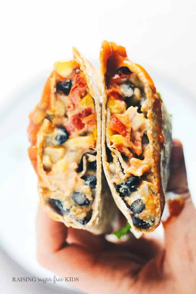 Sweet Potato & Black Bean Wraps | Raising Sugar Free Kids - a really easy, really tasty vegetable-packed dish that takes mins to make and is made of storecupboard and freezer ingredients. #sugarfreejanuary #budgetrecipes