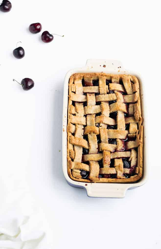 This Delightful Low Sugar Cherry Pie Will Make You Smile | Add Some Veg - this low sugar cherry pie slices into beautiful bars and tastes amazing! Bonus: it has less than 1 tsp sugar per serve, is made with just 8 ingredients, including the 1-minute wholegrain pastry, and is packed with melatonin-inducing cherries for a good night's sleep! #cherrypie #lowsugar #sugarfree #easybaking #kidfriendly #addsomeveg